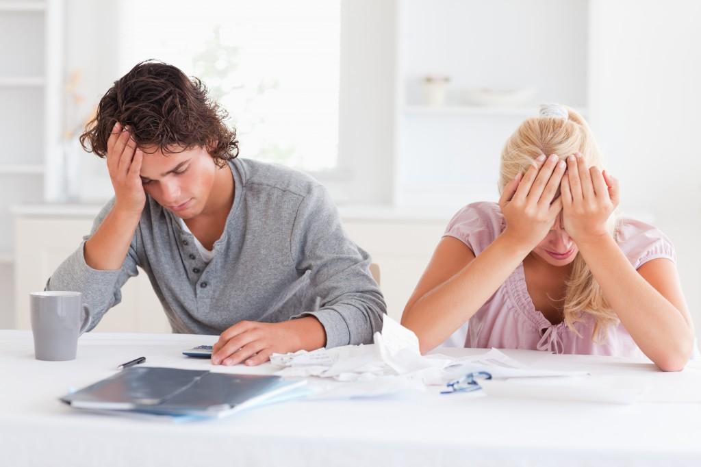 Sad couple while accounting